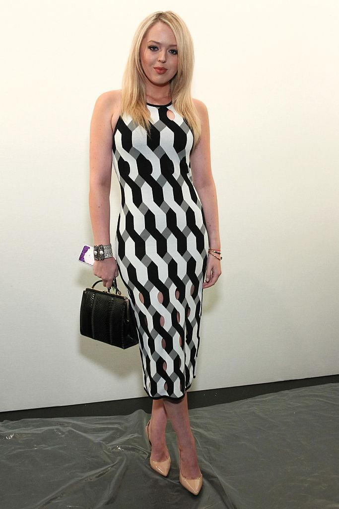 <p>Donning a black and white patterned dress at the Taoray Wang fashion show during New York Fashion Week. <i> (Photo: Getty) </i> </p>