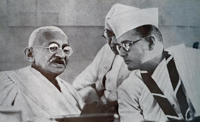 Mohandas K. Gandhi and Subhas Bose, prominent leaders of Indian Freedom Movement, at 51st Indian National Congress in 1938. Subhas Chandra Bose (1897 - 1945), Indian nationalist whose defiant patriotism made him a hero in India, whose attempt during World War II to rid India of British rule with the help of Nazi Germany and Imperial Japan left a troubled legacy. (Photo by: Universal History Archive/ Universal Images Group via Getty Images)