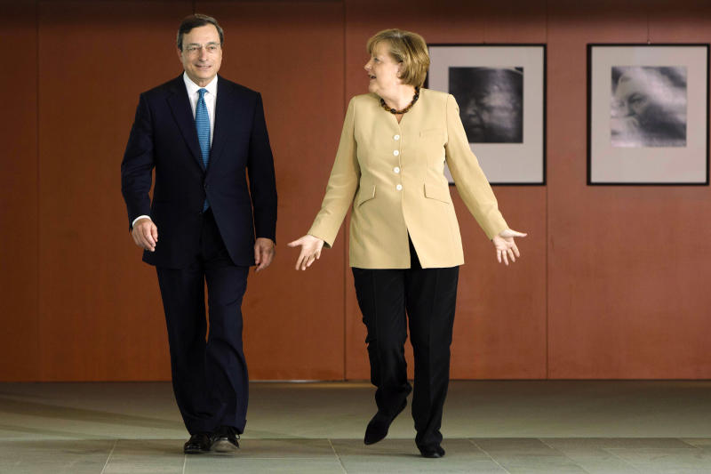 FILE - In this June 16, 2011 file photo, Germany's Chancellor Angela Merkel, right, welcomes the governor of the Banca d'Italia and candidate for the European Central Bank presidency Mario Draghi at the chancellery in Berlin. The worst of Europe's financial crisis appears to be over. European leaders have taken steps to ease the panic that has plagued the region for three turbulent years. Much of the credit for easing Europe's financial crisis goes to the European Central Bank, which has become more aggressive over the past year under the leadership of Mario Draghi. Merkel has also helped ease financial tensions across the region by speaking more forcefully about the need to hold the euro together. (AP Photo/Markus Schreiber, File)