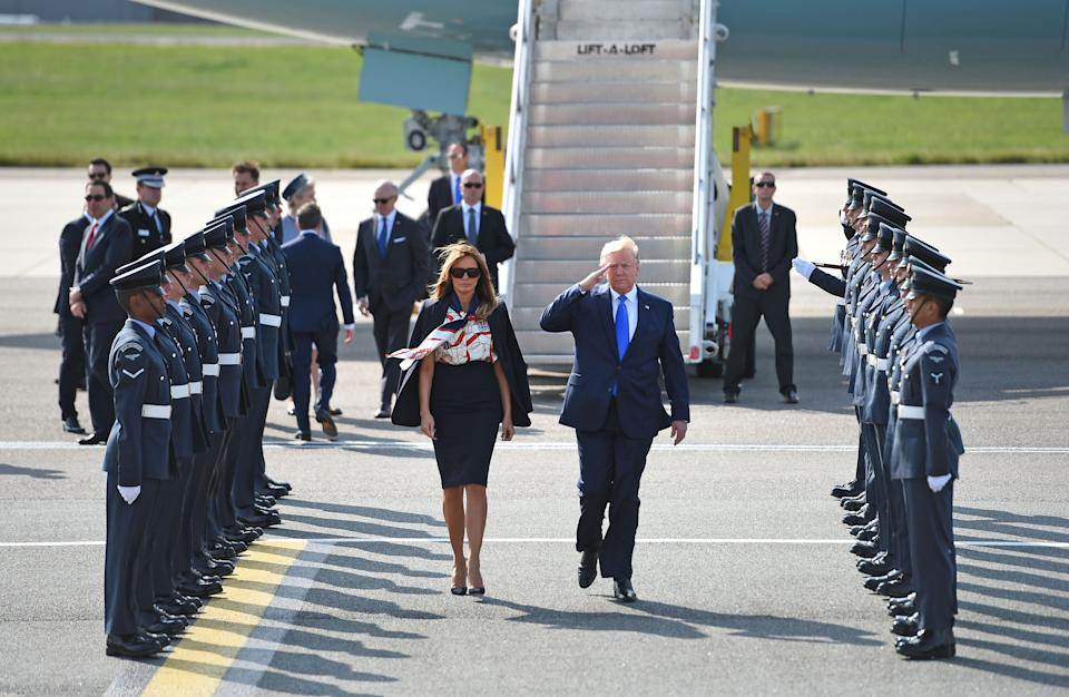 Mr Trump and his wife Melania are greeted at Stansted Airport (Picture: PA)