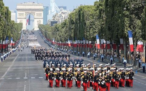 Military regiments in the annual Bastille Day military parade on the Champs-Elysees avenue near the Arc de Triomphe in Paris on July 14, 2018 - Credit: Ludovic Marin/AFP