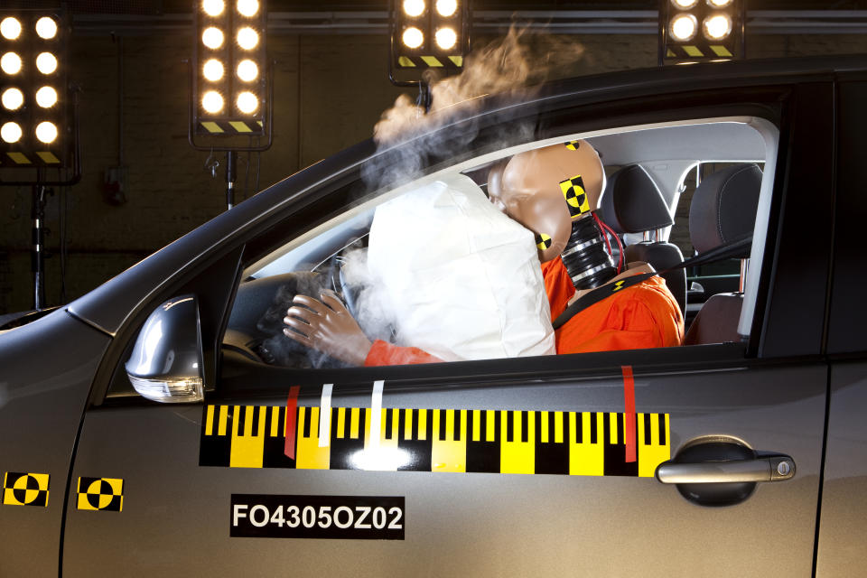 An airbag deploying during a crash test