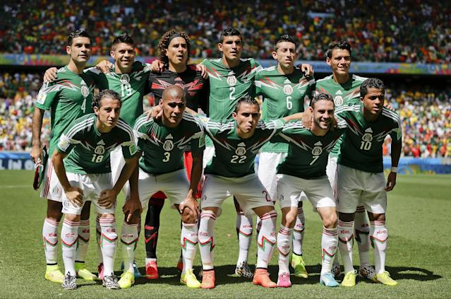 Mexico's national team poses before the World Cup round of 16 soccer match between the Netherlands and Mexico at the Arena Castelao in Fortaleza, Brazil, Sunday, June 29, 2014. (AP Photo/Felipe Dana)