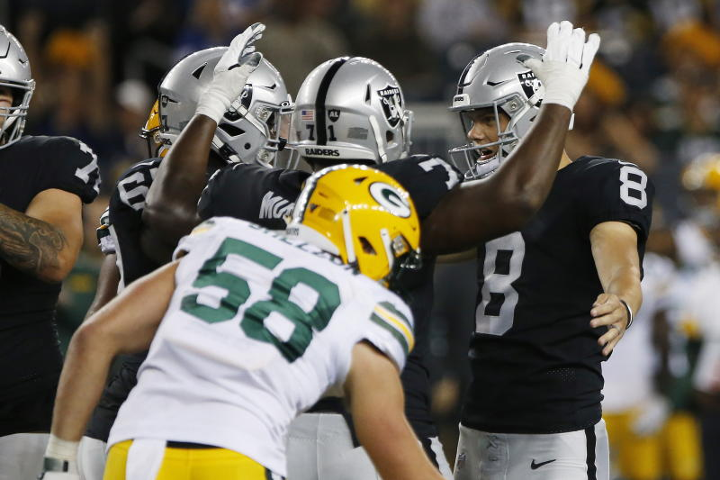 Oakland Raiders' Daniel Carlson (8) celebrates his go-ahead field goal against the Green Bay Packers in the final minute of an NFL preseason football game Thursday, Aug. 22, 2019, in Winnipeg, Manitoba. (John Woods/The Canadian Press via AP)
