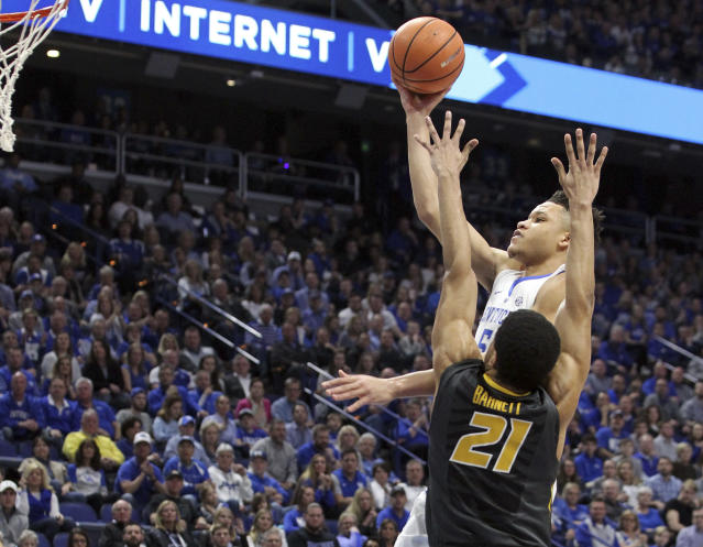 Kentucky's Kevin Knox, top, shoots while defended by Missouri's Jordan Barnett (21) during the first half of an NCAA college basketball game Saturday, Feb. 24, 2018, in Lexington, Ky.(AP Photo/James Crisp)