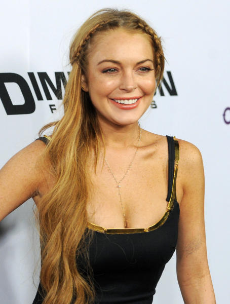 """FILE - This April 11, 2013 file photo shows actress Lindsay Lohan, a cast member in """"Scary Movie V,"""" at the premiere of the film in Los Angeles. OWN announced that the network will air an exclusive interview with Oprah Winfrey and Lindsay Lohan that will tape and air in August and an eight-part documentary series with Lindsay for 2014. (Photo by Chris Pizzello/Invision/AP, File)"""