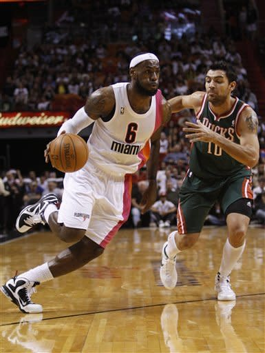 Miami Heat's LeBron James (6) drives to the basket past Milwaukee Bucks' Carlos Delfino (10) during the first half of an NBA basketball game, Sunday, Jan. 22, 2012, in Miami. (AP Photo/Lynne Sladky)