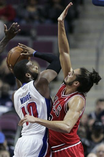 Detroit Pistons center Greg Monroe (10) tries going to the basket against Chicago Bulls center Joakim Noah in the first half of an NBA basketball game, Friday, Dec. 7, 2012, in Auburn Hills, Mich. (AP Photo/Duane Burleson)