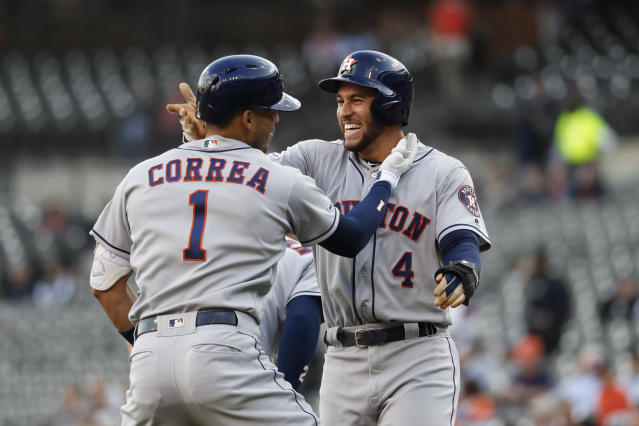 Houston Astros' Carlos Correa (1) celebrates his three-run home run with George Springer (4) during the first inning of the team's baseball game against the Detroit Tigers in Detroit, Tuesday, May 14, 2019. (AP Photo/Paul Sancya)