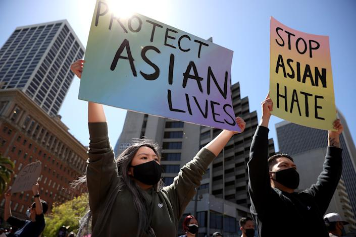 Protesters held signs during a March rally in San Francisco at which hundreds of people marched through downtown to show solidarity with Asian Americans, who have been the targets of hate crimes across the United States. (Photo by Justin Sullivan/Getty Images) ***BESTPIX*** ORG XMIT: 775636267 ORIG FILE ID: 1309328004