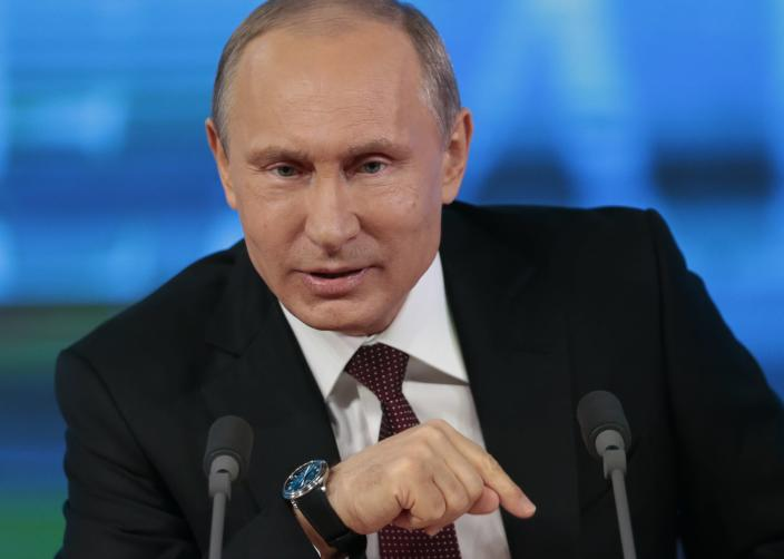 Russian President Vladimir Putin speaks at his annual news conference in Moscow, Russia, Thursday, Dec. 19, 2013. Putin says the National Security Agency surveillance program is necessary to fight terrorism, but must be regulated by strict rules and norms. (AP Photo/Ivan Sekretarev)