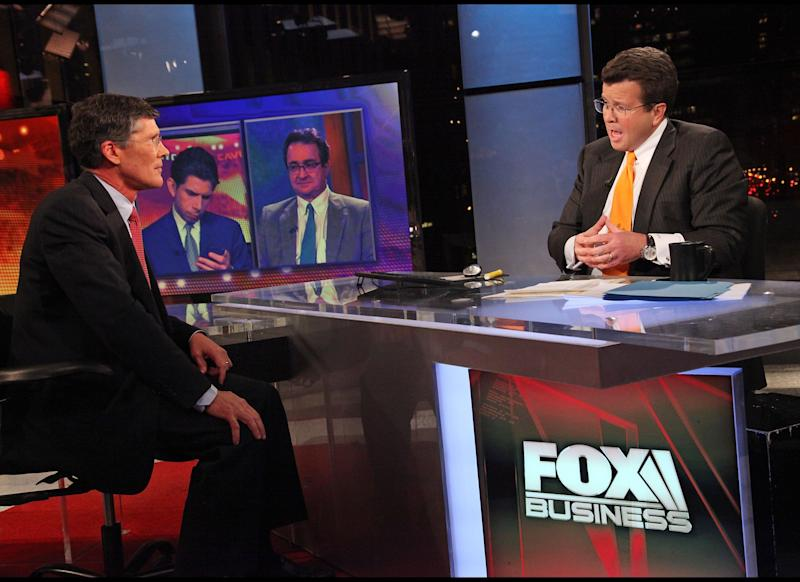 NEW YORK, NY - OCTOBER 27: (EXCLUSIVE COVERAGE) FOX Business Network's Neil Cavuto (R) interviews former Merrill Lynch Chief Executive and current head of CIT Group John Thain at FOX Studios on October 27, 2011 in New York City. (Photo by Rob Kim/Getty Images)
