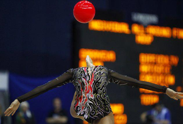 Ulyana Trofimova of Uzbekistan performs with the ball during the individual all-around competition final at the Rhythmic Gymnastics World Championships in Moscow September 24, 2010. (REUTERS/Mikhail Voskresensky)
