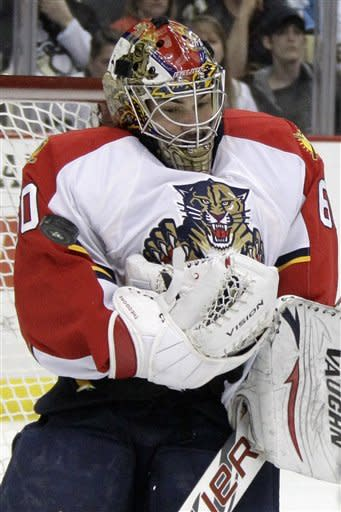 Florida Panthers goalie Jose Theodore (60) makes a save in the second period of an NHL hockey game against the Pittsburgh Penguins in Pittsburgh on Friday, March 9, 2012. (AP Photo/Gene J. Puskar)