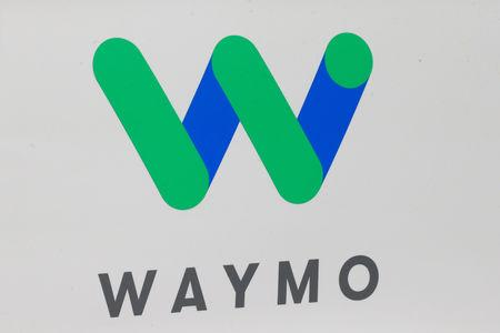 FILE PHOTO: The Waymo logo is displayed during the company's unveil of a self-driving Chrysler Pacifica minivan during the North American International Auto Show in Detroit, Michigan, U.S., January 8, 2017.  REUTERS/Brendan McDermid