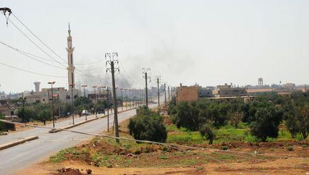 Syrian forces reach Jordanian border crossing as rebels negotiate surrender