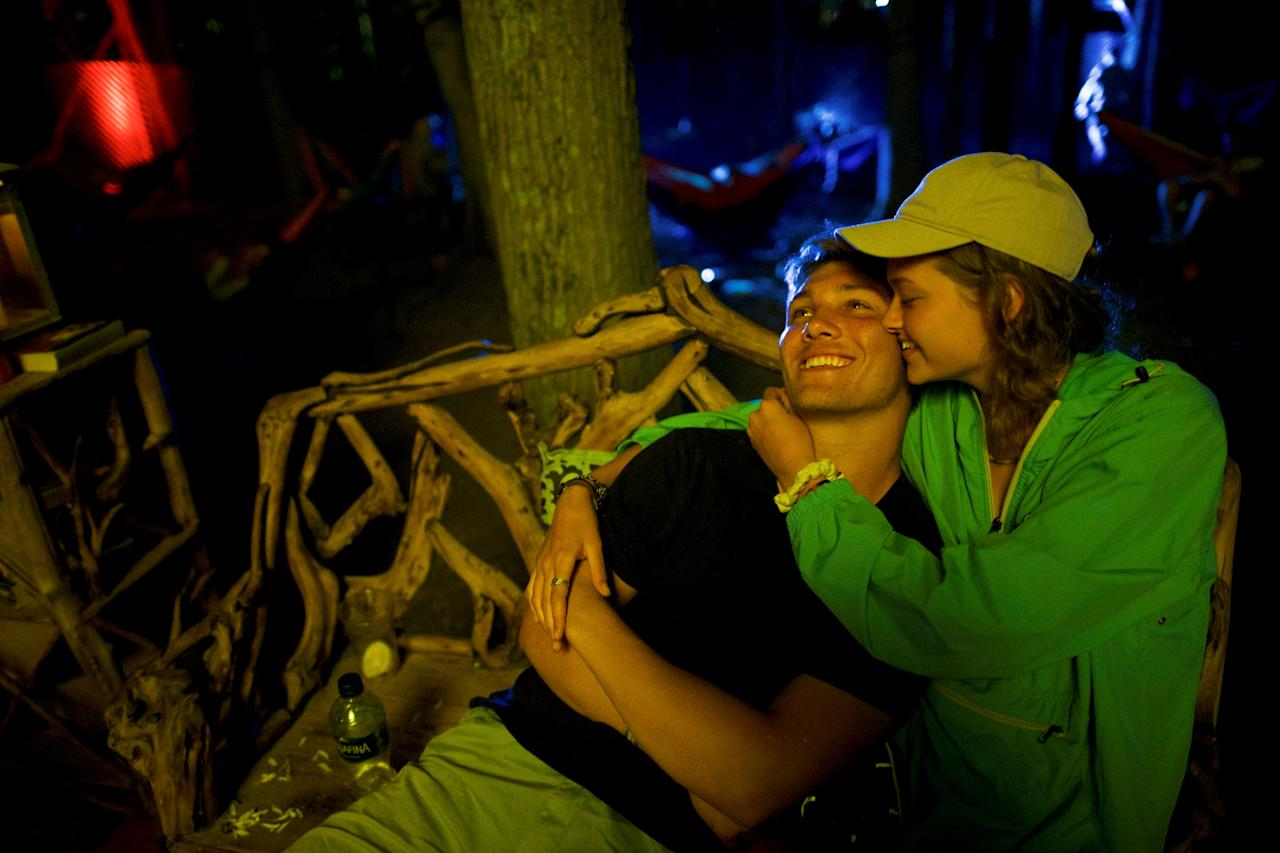 Tyler Cury, 18, and Morgan Coley, 18, embrace on the fourth and final day of the Firefly Music Festival in Dover, Delaware U.S., June 17, 2018.  REUTERS/Mark Makela