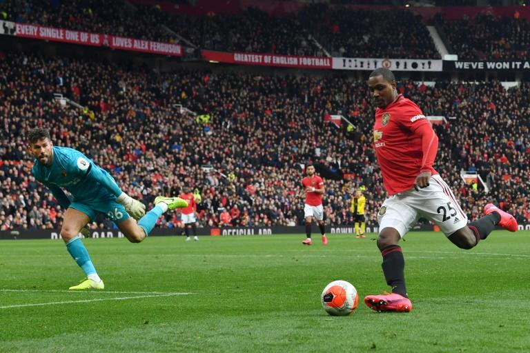 Odion Ighalo has joined Manchester United from China's Shanghai Shenhua on loan (R) rounds Watford's English goalkeeper Ben Foster (L) during the English Premier League football match between Manchester United and Watford at Old Trafford in Manchester, north west England, on February 23, 2020