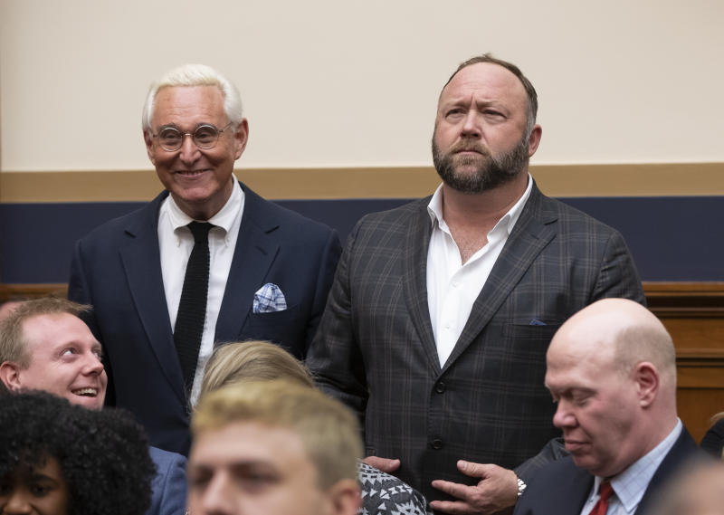 Roger Stone, a confidant of President Trump, left, and radio show host and conspiracy theorist Alex Jones, right, enter the House Judiciary Committee hearing room. (ASSOCIATED PRESS)