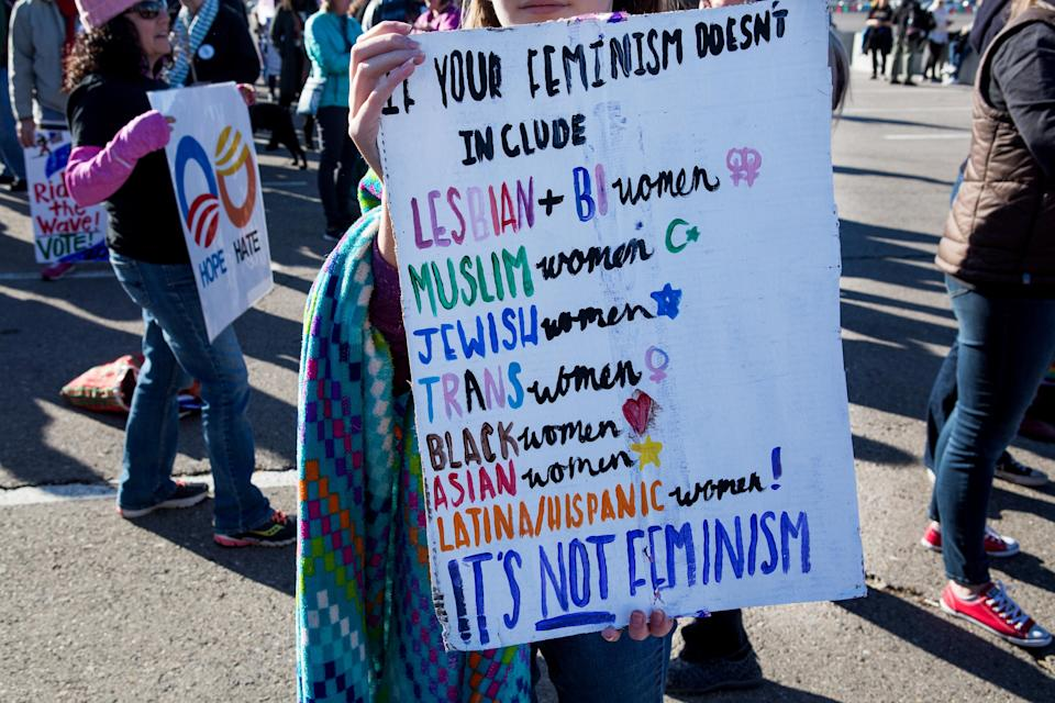 An attendee holds a sign before entering the Sam Boyd Stadium during the Women's March Anniversary: Power to the Polls event in Las Vegas on Jan. 21. (Photo: Michelle Gustafson/Bloomberg)
