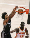 Sacramento Kings' Marvin Bagley III (35) scores against Atlanta Hawks guard Tony Snell (19) during the first half of an NBA basketball game on Saturday, March 13, 2021, in Atlanta. (AP Photo/Brynn Anderson)