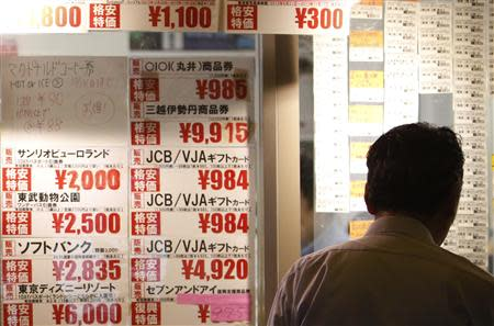 A man looks at prices at a ticket shop in Tokyo October 1, 2013. REUTERS/Yuya Shino