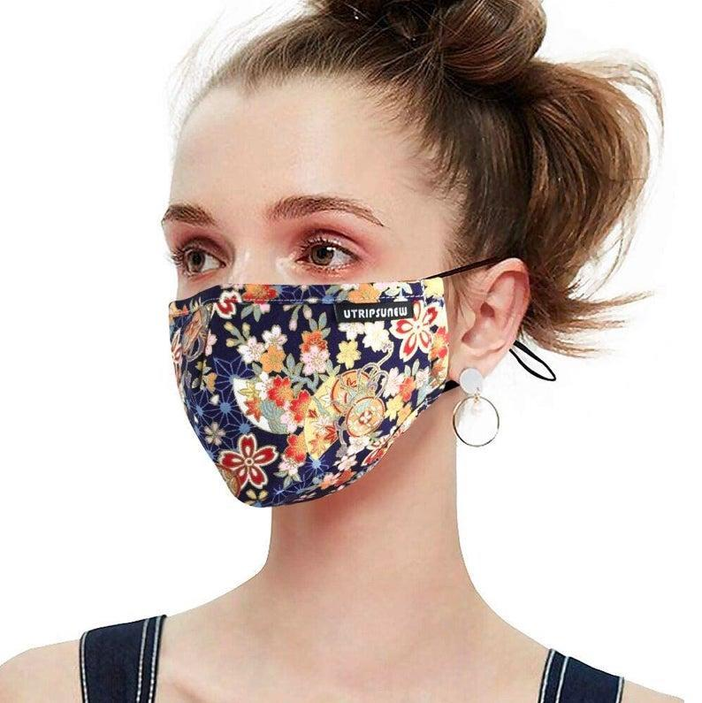 """With its adjustable ear loops, soft fabric, and included carbon inserts for added filtration, you'll feeling safe <em>and</em> cute wearing this mask, which is available in various colors and prints. $20, Amazon. <a href=""""https://www.amazon.com/Pollution-Washable-Reusable-Protection-Respirator/dp/B07KDBVFVM/ref=sr_1_2?"""" rel=""""nofollow noopener"""" target=""""_blank"""" data-ylk=""""slk:Get it now!"""" class=""""link rapid-noclick-resp"""">Get it now!</a>"""