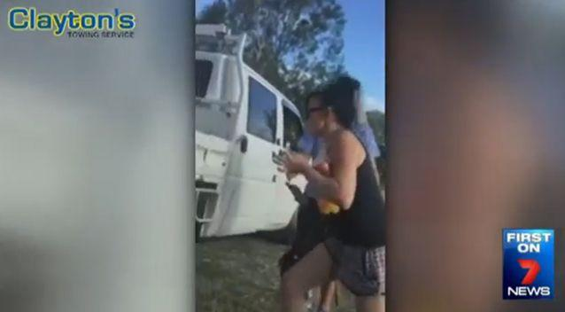 The woman was filmed trying to leave the scene but was apprehended. Photo: 7 News