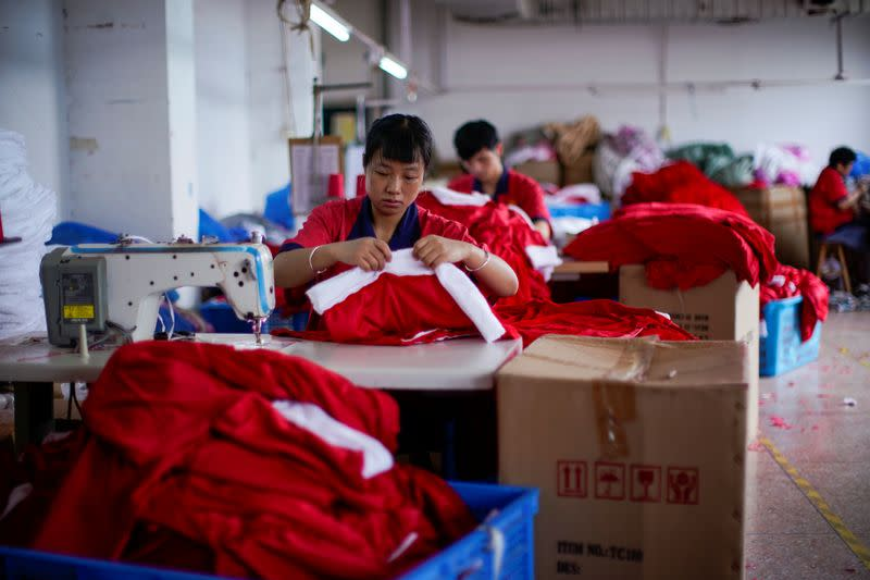 Employees make Christmas products at Fuye toy factory following the coronavirus disease (COVID-19) outbreak in Yiwu
