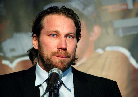 FILE PHOTO: Swedish forward Peter Forsberg of the Colorado Avalanche chokes up as he announces his retirement from the game at a news conference in Denver February 14, 2011. REUTERS/Rick Wilking/File Photo