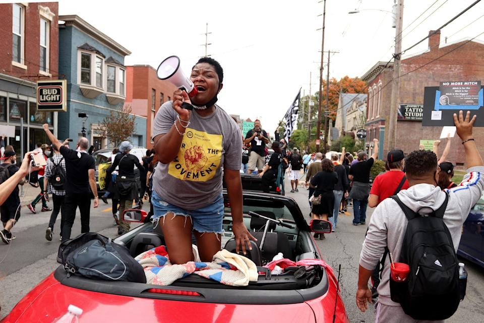 Sadiqa Reynolds, president and CEO of the Louisville Urban League, leads chants from a convertible during a march for Breonna Taylor. Oct. 10, 2020