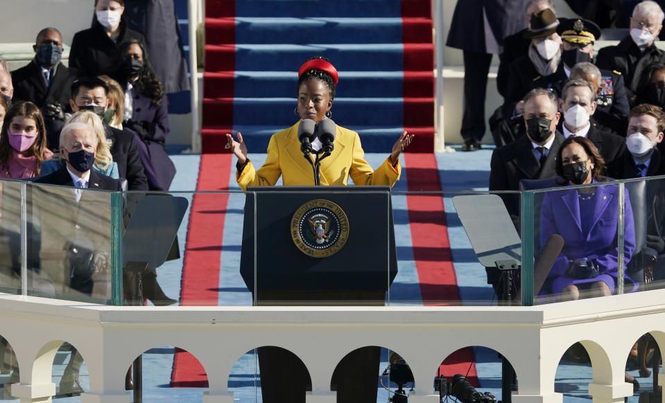 National youth poet laureate Amanda Gorman recites her inaugural poem during the 59th Presidential Inauguration at the U.S. Capitol in Washington, Wednesday, Jan. 20, 2021. Joe Biden became the 46th president of the United States on Wednesday. (AP Photo/Patrick Semansky, Pool)