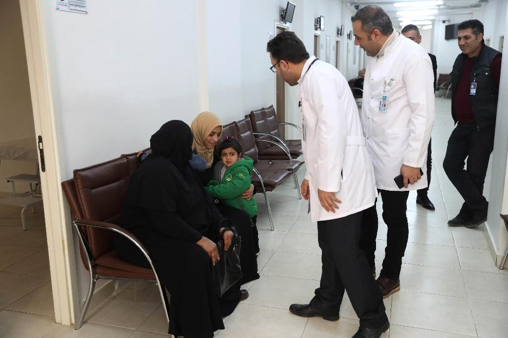 Safa al-Hussein brings her four-year-old daughter, Ahed, who was injured in an attack on the northern Syrian city of Raqa, to be treated by exiled Syrian doctors at a healthcare centre in the Turkish capital, Ankara (AFP Photo/ADEM ALTAN)
