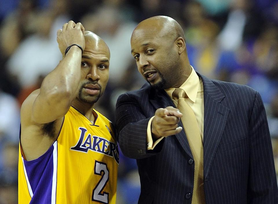 Lakers assistant coach Brian Shaw talks with point guard Derek Fisher during a preseason game in 2010.
