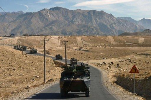French military vehicles travel in a convoy from Nijrab to Kabul following their departure from France's Camp Nijrab. France ended its combat mission in Afghanistan on Tuesday, withdrawing troops from a strategic province northeast of Kabul as part of a quickened departure from the war-torn country