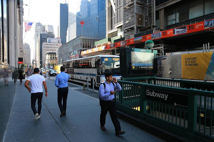 <p>Early morning rush hour traffic along Church Street past the Cortlandt Street subway station on Aug. 29, 2016, across the street from the World Trade Center site. (Gordon Donovan/Yahoo News) </p>