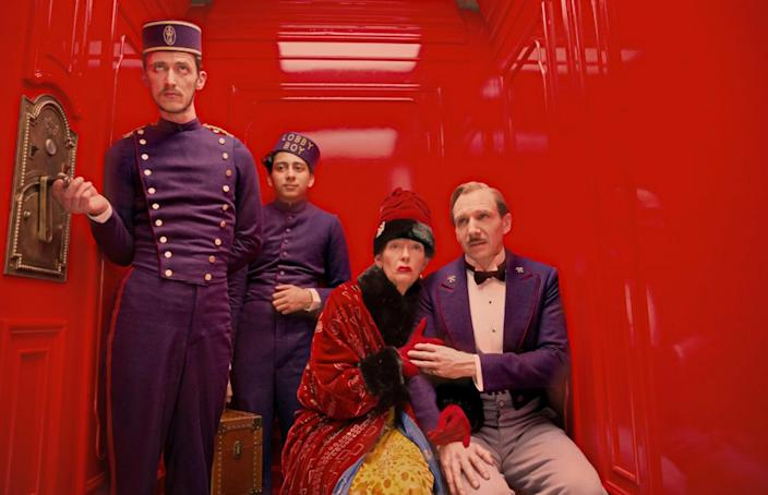 """<h1 class=""""title"""">THE GRAND BUDAPEST HOTEL 2014 Fox Searchlight film with Ralph Fiennes at right with Tilda Swinton. Image shot 2014. Exact date unknown.</h1> <div class=""""caption""""> <em>The Grand Budapest Hotel</em> received four Oscars, including one for best production design. </div> <cite class=""""credit"""">Photo: Pictorial Press Ltd / Alamy Stock Photo</cite>"""
