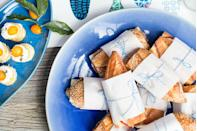 """<p>Slice up hearty sandwiches, then wrap 'em up in wax paper and tie them with twine, recommends <a href=""""https://www.goodhousekeeping.com/food-recipes/party-ideas/tips/a32365/emily-henderson-target-spring-entertaining/"""" rel=""""nofollow noopener"""" target=""""_blank"""" data-ylk=""""slk:Henderson"""" class=""""link rapid-noclick-resp"""">Henderson</a>. Her crowd-pleasing go-to? A baguette topped with ham, provolone and salted butter. </p>"""