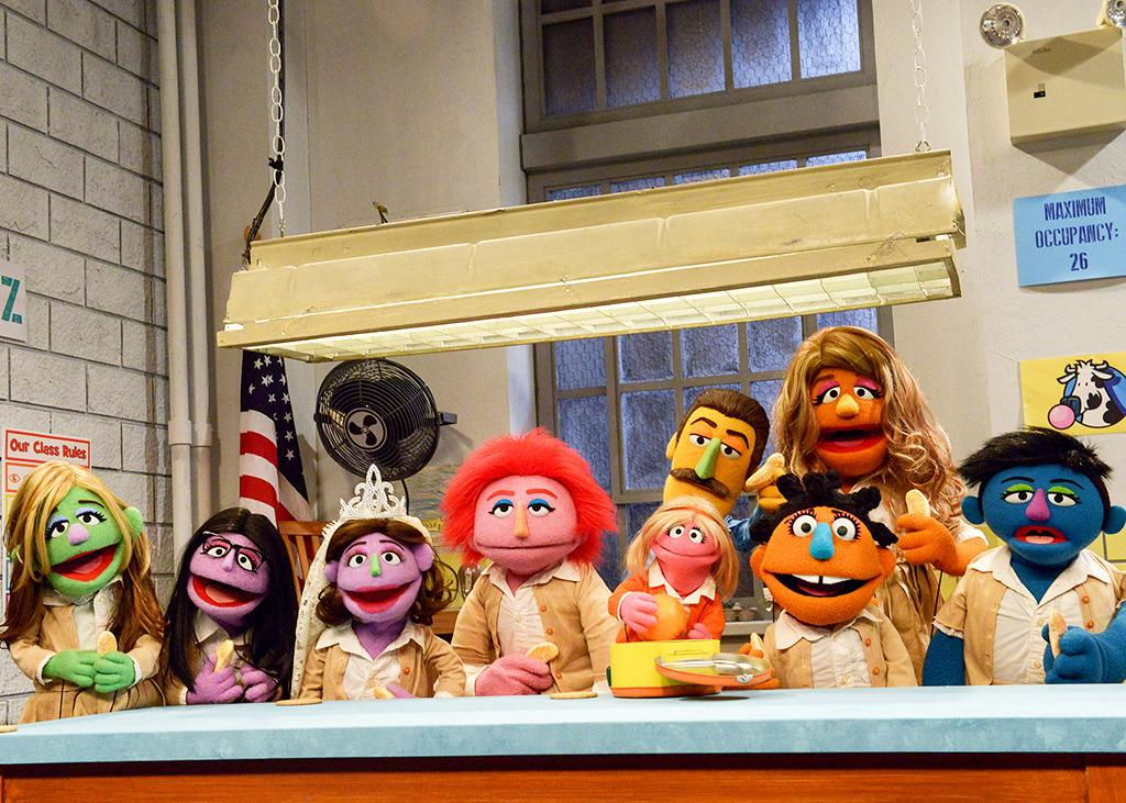 <p>Check out the wedding headdress on Forlorna in this group shot of the entire <i>Orange Is the New Snack</i>Muppet cast. Itsmartly reflects the oft-lovelorn Lorna's surprise exchange of vows on Season 3 of <i>OITNB</i>. </p><p><i>(Credit: Sesame Workshop/HBO)</i></p>