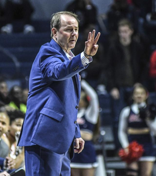 Mississippi head coach Kermit Davis sends in a signal during the first half of an NCAA college basketball game against Arkansas State, Friday, Nov. 8, 2019 in Oxford, Miss. (Bruce Newman/The Oxford Eagle via AP)