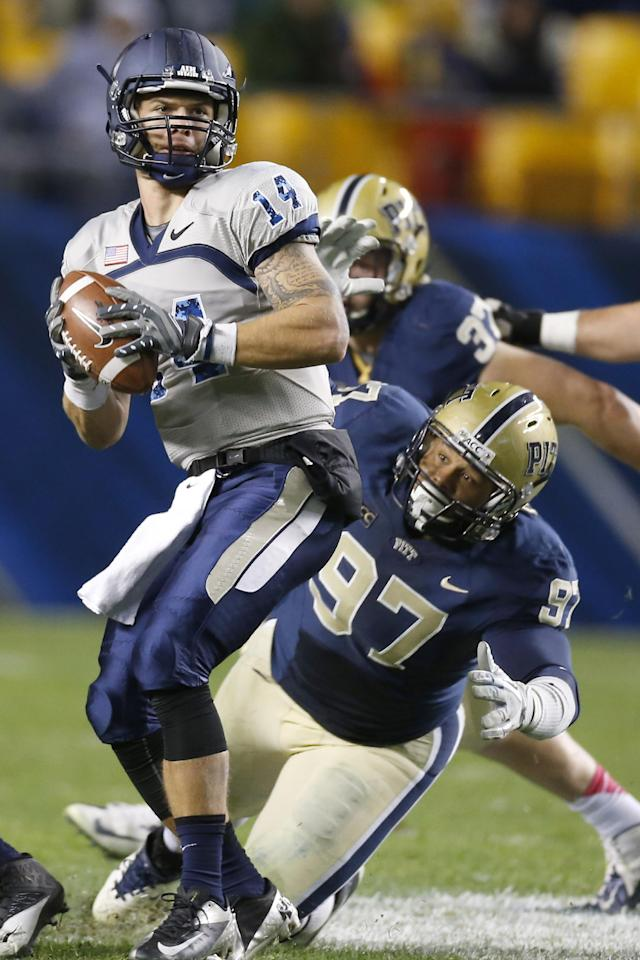 FILE - In this Oct. 19, 2013, file photo, Pittsburgh defensive lineman Aaron Donald (97) pressures Old Dominion quarterback Taylor Heinicke (14) during an NCAA football game in Pittsburgh. Donald, the most-decorated defensive player during the 2013 college football season with four major awards, could be the Panthers' highest draft pick since wideout Larry Fitzgerald was taken third overall by the Arizona Cardinals in 2004. (AP Photo/Keith Srakocic, File)