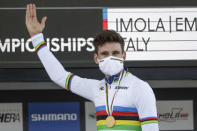 Italy's Filippo Ganna celebrates on the podium after winning the men's Individual Time Trial event, at the road cycling World Championships, in Imola, Italy, Friday, Sept. 25, 2020. (AP Photo/Andrew Medichini)
