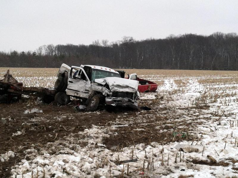 This photo provided by Indiana State Police  shows the scene of a crash between two pick trucks that killed three teenagers Thursday, March 7, 2013 near Versailles, Ind. Sgt. Noel Houze said during a news conference Thursday that the six students involved in the crash attended South Ripley County High School in Versailles, a small community about 45 miles west of Cincinnati. (AP Photo/Indiana State Police)