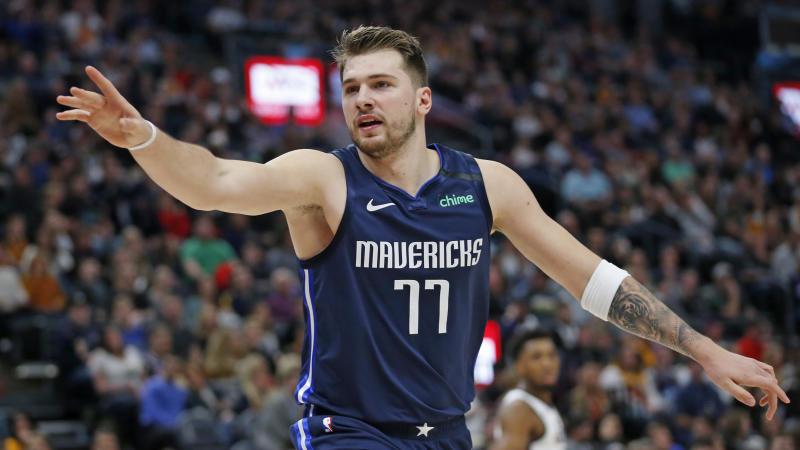 Dallas Mavericks guard Luka Doncic (77) directs his team in the first half during an NBA basketball game against the Utah Jazz Saturday, Jan. 25, 2020, in Salt lake City. (AP Photo/Rick Bowmer)