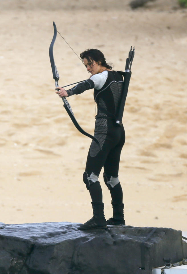 "Jennifer Lawrence stands on a pedestal with camera crews surrounding it during filming for a scene in ""The Hunger Games: Catching Fire"" in the water just off shore in Hawaii.