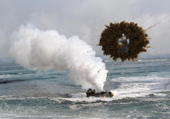 A South Korean marine LVT-7 landing craft sail to shores through a smoke screen during the U.S.-South Korea joint landing exercises called Ssangyong, part of the Foal Eagle military exercises, in Pohang, South Korea, Monday, March 31, 2014. South Korea said North Korea has announced plans to conduct live-fire drills near the rivals' disputed western sea boundary. The planned drills Monday come after an increase in threatening rhetoric from Pyongyang and a series of rocket and ballistic missile launches in an apparent protest against the annual military exercises by Seoul and Washington. (AP Photo/Ahn Young-joon)