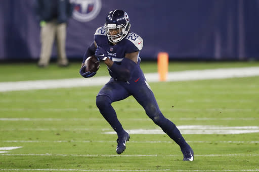 Tennessee Titans running back Derrick Henry carries the ball against the Indianapolis Colts in the first half of an NFL football game Thursday, Nov. 12, 2020, in Nashville, Tenn. (AP Photo/Wade Payne)