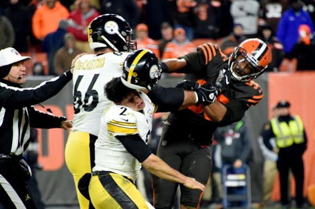 Cleveland's Myles Garrett fought with Pittsburgh's Mason Rudolph (number two) David de Castro (66) during their game last November (AFP Photo/Jason Miller)
