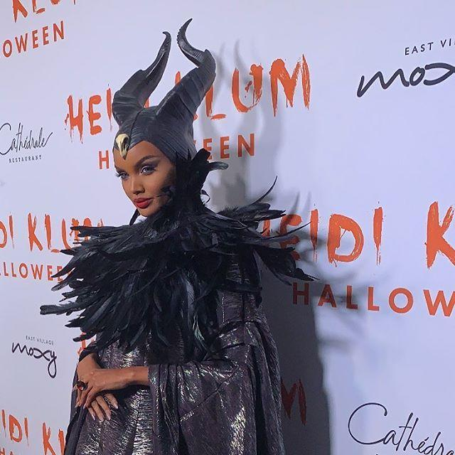 """<p>Between the feather neck piece, the floor-length gown, and the headpiece, this costume will keep you warm from head (horns?) to toe.</p><p><a href=""""https://www.instagram.com/p/B6oYpvTB74p/"""" rel=""""nofollow noopener"""" target=""""_blank"""" data-ylk=""""slk:See the original post on Instagram"""" class=""""link rapid-noclick-resp"""">See the original post on Instagram</a></p>"""