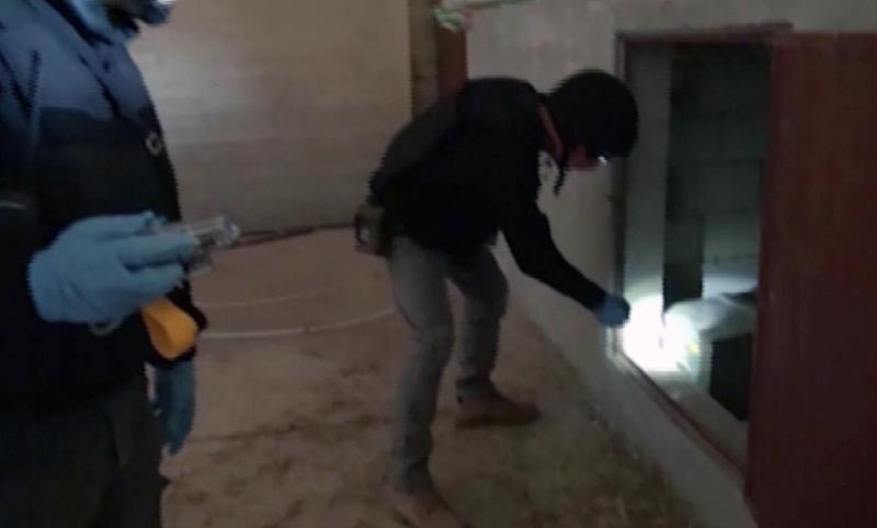 An image grab taken from Syrian television on October 10, 2013 shows inspectors from the Organisation for the Prohibition of Chemical Weapons (OPCW) at work at an undisclosed location in Syria
